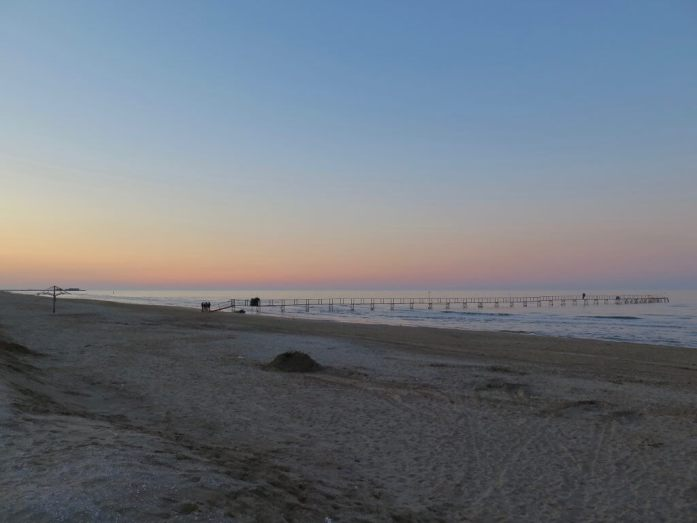 A calm, quiet sunset on the beach in Rimini, Italy.
