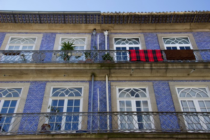 Homes with balconies and blue tiles seen on a two-day layover in Porto, Portugal. ©KettiWilhelm2020