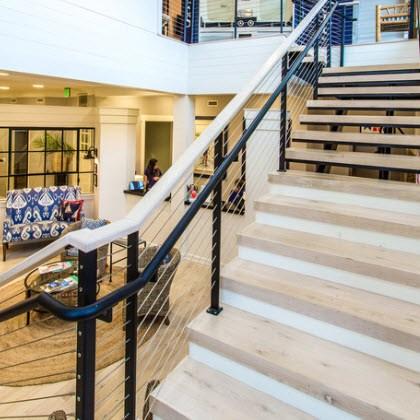 Main Lobby Staircase Cable Railing Gulfport Ms Keuka Studios | Wood And Cable Stair Railing | Dark | Diy | Exterior Irregular Stair | Residential | Forgings