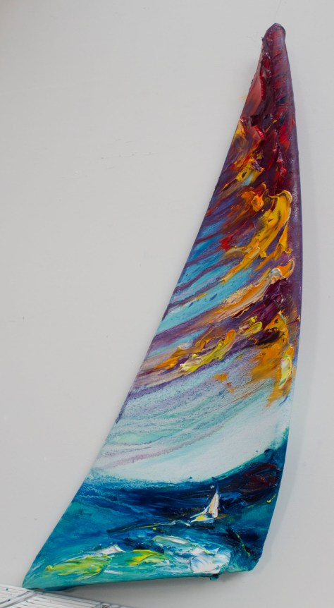 sail-shaped painting of sailing boat at sea in colourful impasto