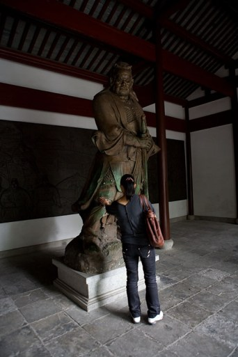 A lot of people reach out to touch Yue Fei, who's considered a hero in Chinese culture.