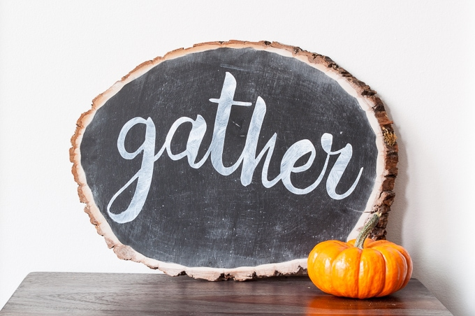 DIY tutorial for this pretty gather chalkboard wood slice sign. Easy way to create hand-lettered chalk designs.