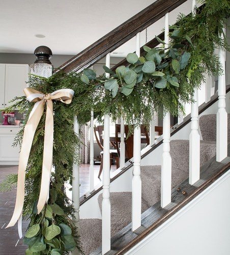 Create this beautiful pine and eucalyptus Christmas garland for your home. It looks so realistic but it's actually fake! I love the mixed green look.