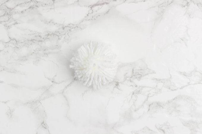 Make the perfect pom poms using this easy to use tool! I love pom poms in modern home decor. They are so trendy right now and super playful!