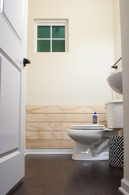 Tutorial for creating modern shiplap. I love the clean crisp look of the white shiplap in this powder room!