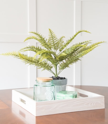 Create a beautiful DIY faux fern arrangement using supplies from your local craft store. See the full tutorial for this easy home decor project.