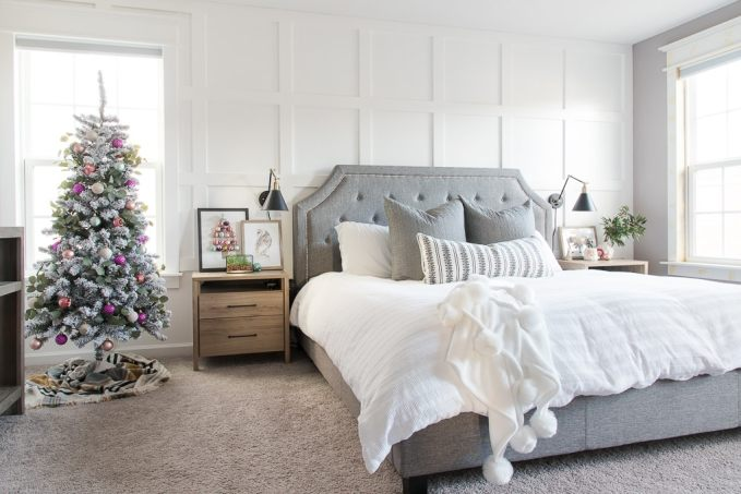 Colorful modern Christmas master bedroom. Bright and fun colors make this room look wintery and festive for the holidays!