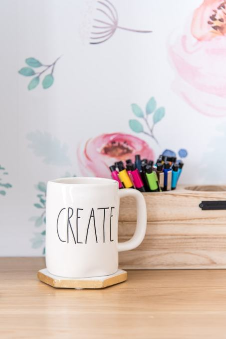 create rae dunn mug on desk with colorful pens