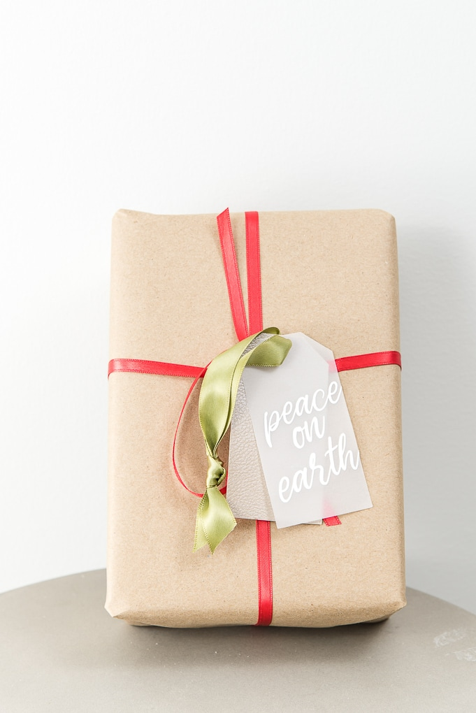 peace on earth layered gift tag on brown Christmas gift box