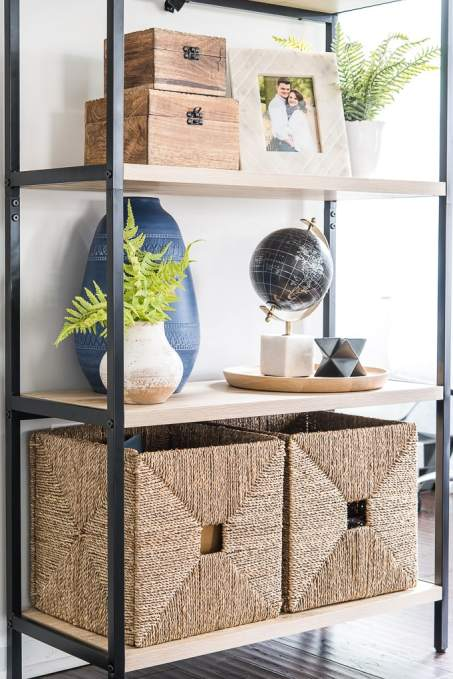 bookshelves with home decor and natural woven baskets