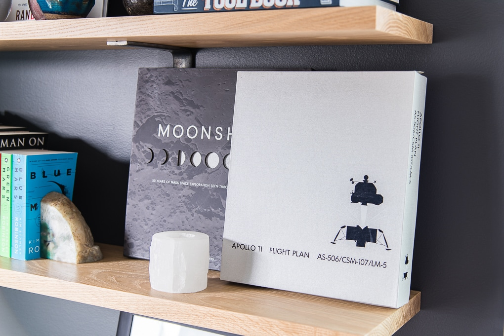 space and moon books on floating shelves