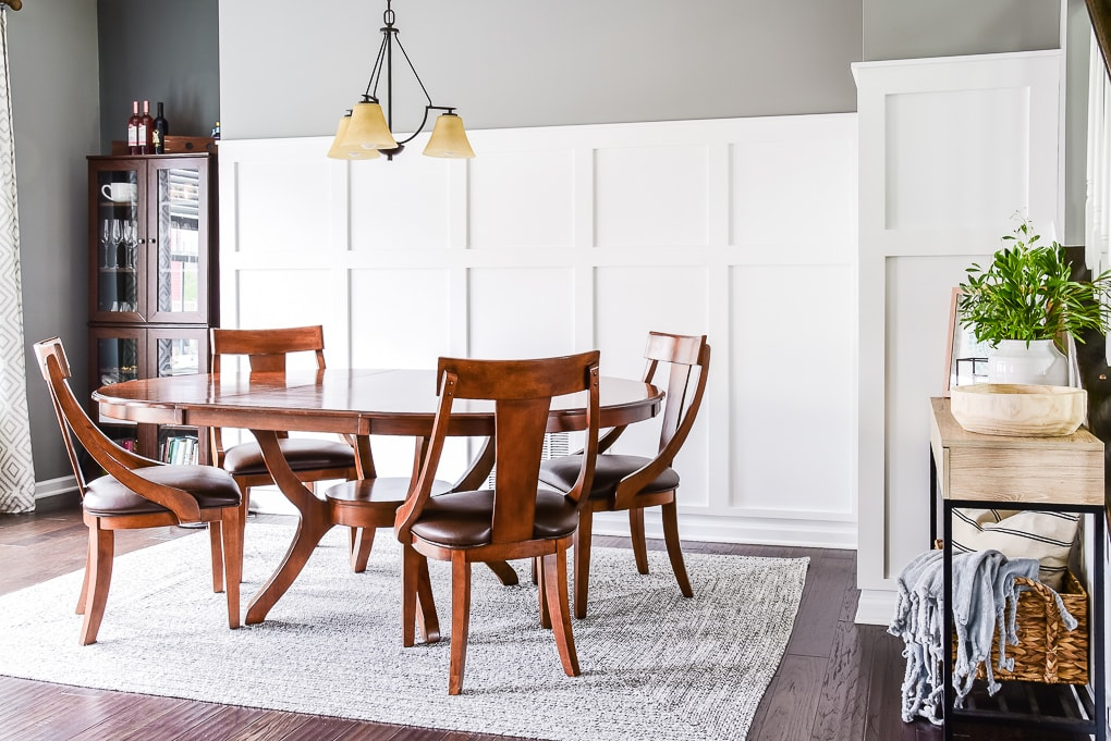 dining room table on a gray rug in a dining room
