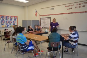 Speech Therapist leading class discussion.
