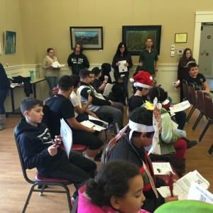 Students caroling at the Senior Center.