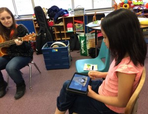 Students using iPad to make music.