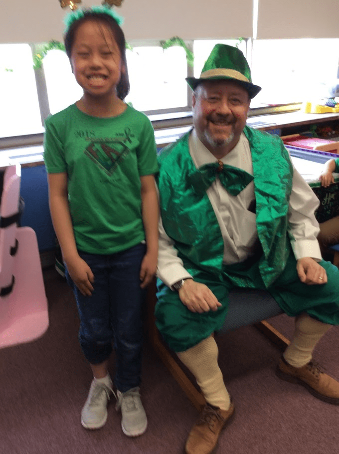 Leprechaun visit with students.