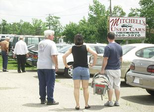 folks-look-over-cars-on-the-lot