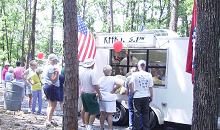 Folks Gather Around the KFFB Remote Trailer for Petit Jean Hot Dogs and Ice Cold Pepsi