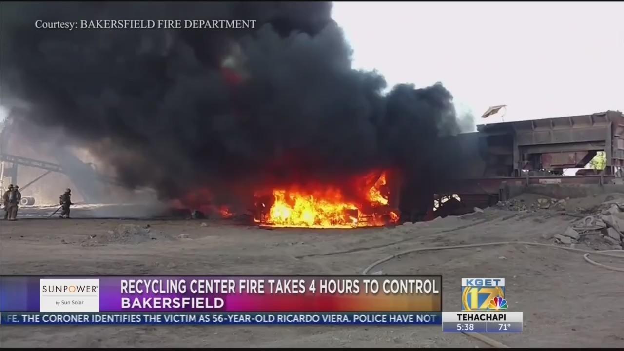 Firefighters battle hours-long recycling center fire