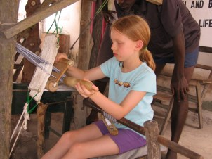 Isabel learning to weave kente