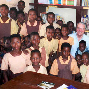 Nick Van Dyck reading with KOBLAS students in the library