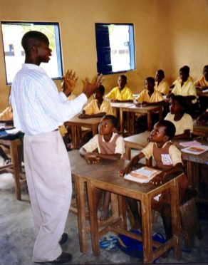 Michael Agbodeka teaching a primary class