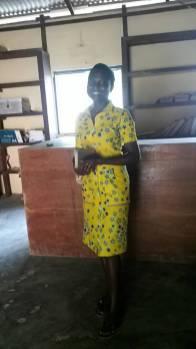 Fafali Agbeli working in the Ann M. Martin Library of the Kopeyia School