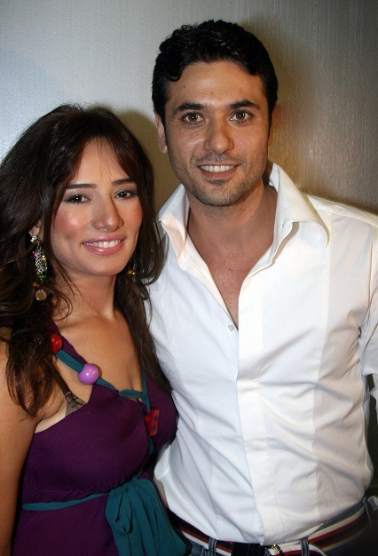 Egyptian actors Ahmed Izz and Zeina pose