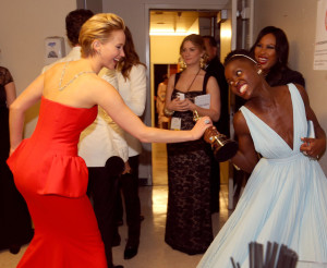 Jennifer-Lawrence-playfully-grabbed-Lupita-Oscar-300x246