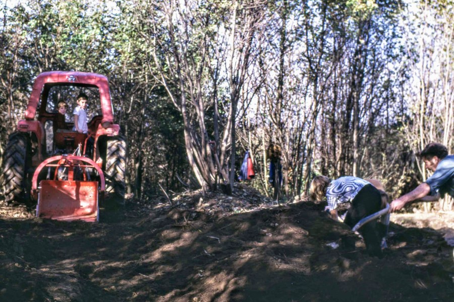 The dig team grapples with thick vegetation and heavy soil with the use of a tractor and a spot of child labour, November 1971.