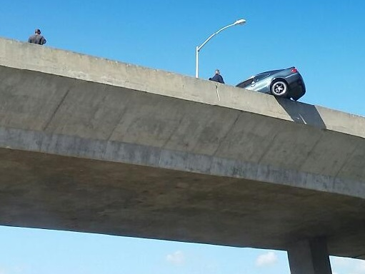 car hanging over ramp_138878