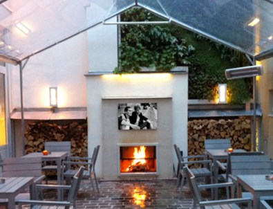 a burning log fire in the hotel courtyard