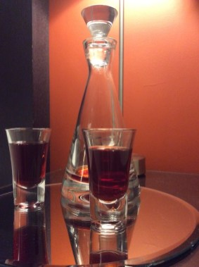 decanter and two glasses of sloe gin