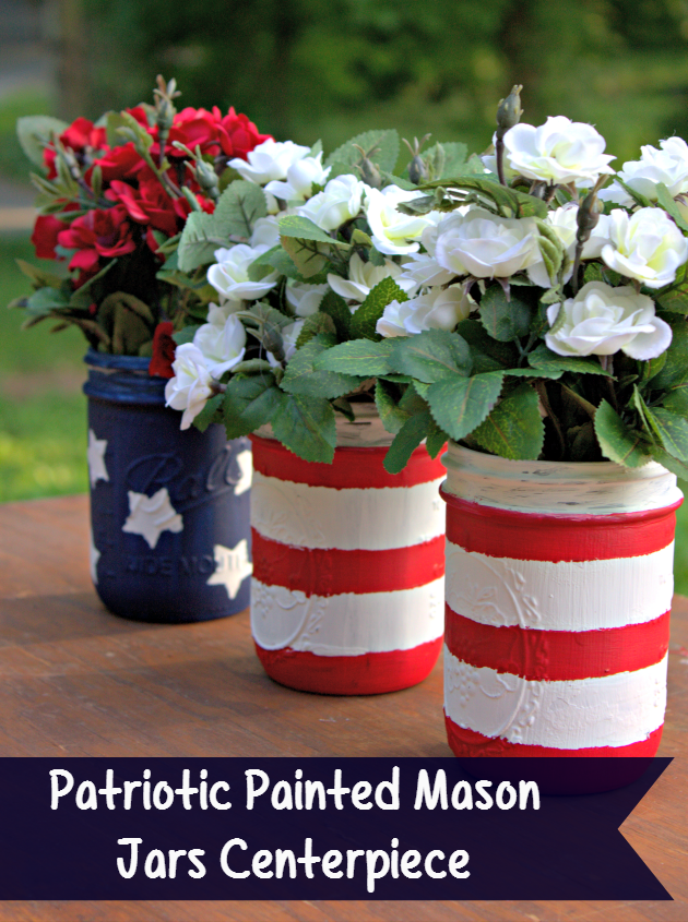 This DIY Rustic Patriotic Painted Mason Jars Craft is the perfect centerpiece for your next BBQ, picnic or party and cost less than $15, flowers included!