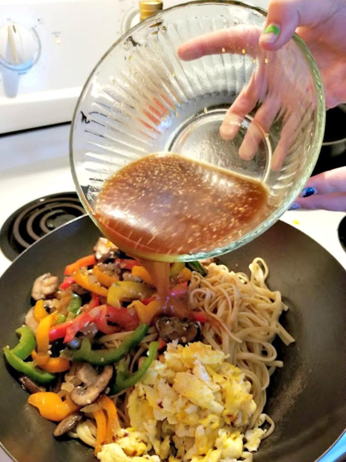 30 Minute Vegetarian Spicy Thai Noodles Recipe adding sauce