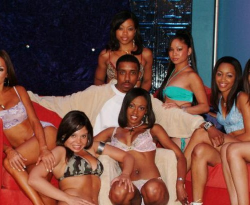 """Ken Francis III  pictured back in the day with his bevy of  beauties on the set of """"The Buckwild Show."""" photo credit:  Joel Payne"""