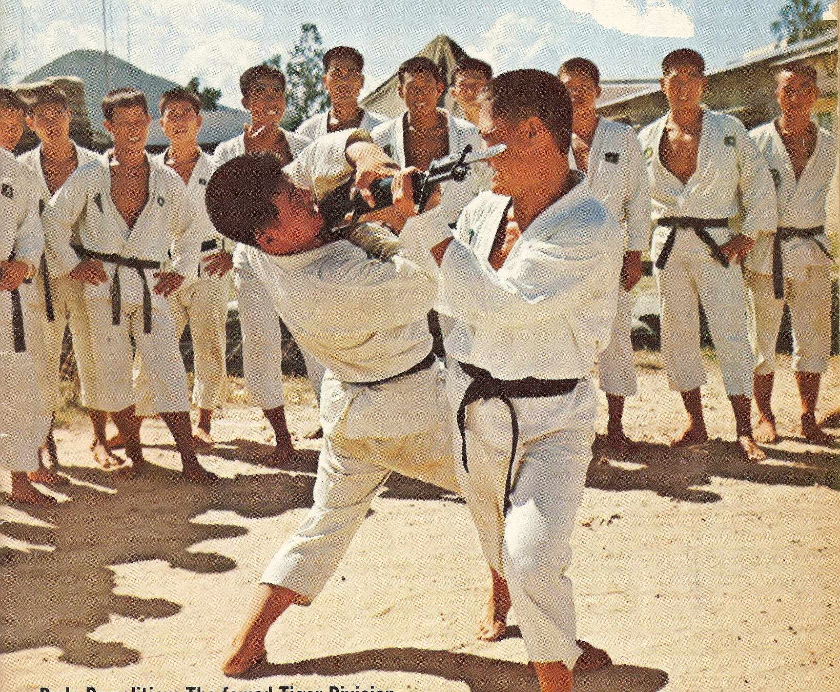 Taekwondo Warriors Training To Kill In Their Black Belts On A Military Base  In Vietnam