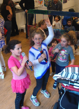 Girls singing karaoke at a Kids at Art party