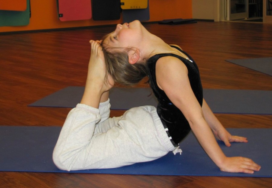 A Yoga Monsters student in Cobra pose