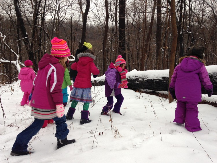 Kids enjoying a winter scavenger hunt at the park. Photo courtesy Pittsburgh Parks Conservancy.