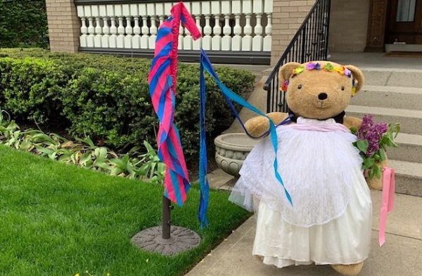 Meet the teddy bear (and silly wardrobe) that brings smiles to the neighborhood