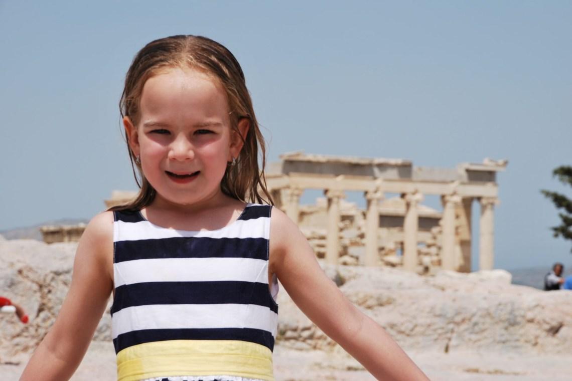 Kid posing infront of Acropolis KidsLoveGreece.com