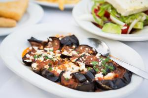 cooked eggplants with feta greek vegan food