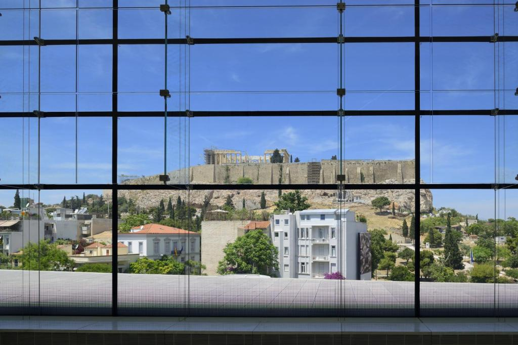 view of Acropolis hill through the Acropolis museum window