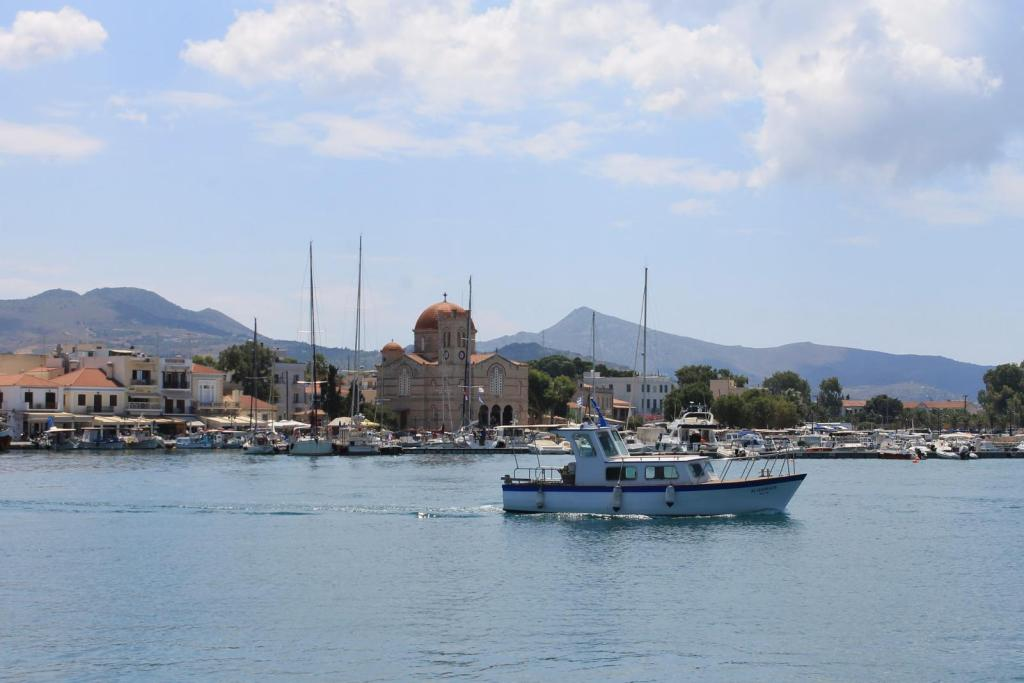 Aegina port boat church Greece