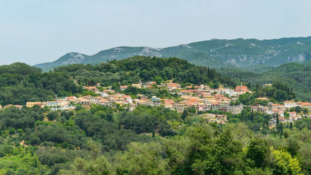 Corfu, a small town built in the mountains between the trees, panorama from the Kaiser throne vantage point DP-min