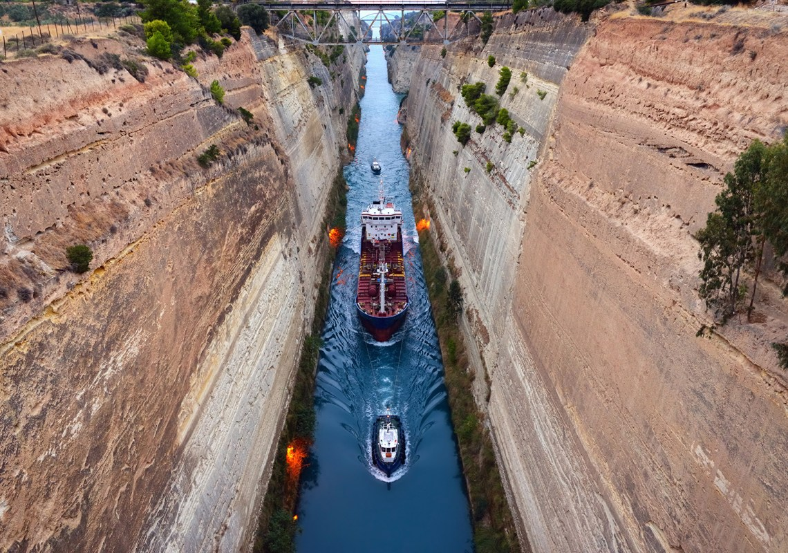 Ship crossing the Corinth Canal in Greece at sunset time