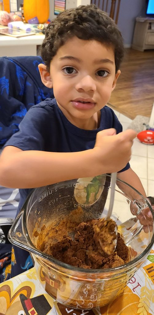 little boy mixing