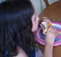 my daughter eating a lean burger