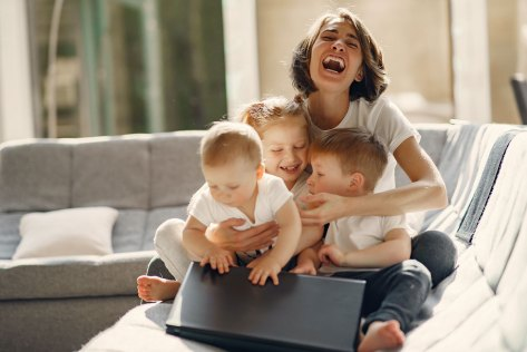 happy mother with children sitting at home